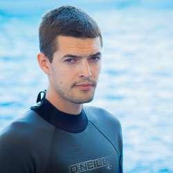 dolphin therapy specialist Yurii Oleksandrovych Mishkurov, photo