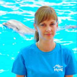 dolphin therapy specialist Maria Kuzmina, photo